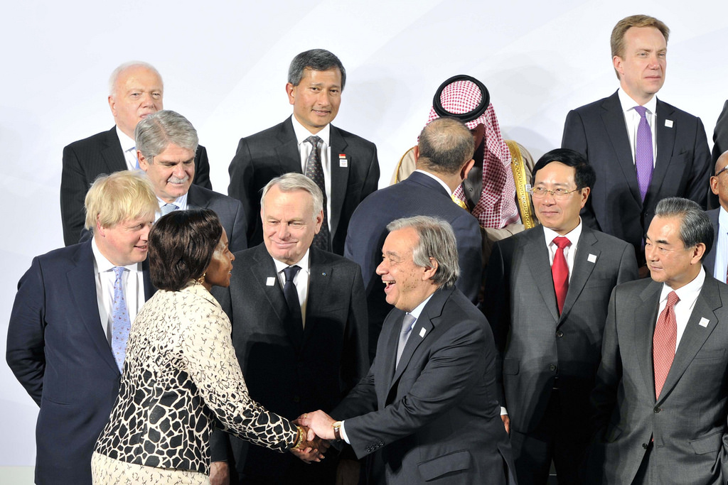 Minister Maite Nkoana-Mashabane greeting United Nations Secretary General, Mr Antonio Guterres during the group photo session at the G20 Minister's Meeting in Bonn, Germany