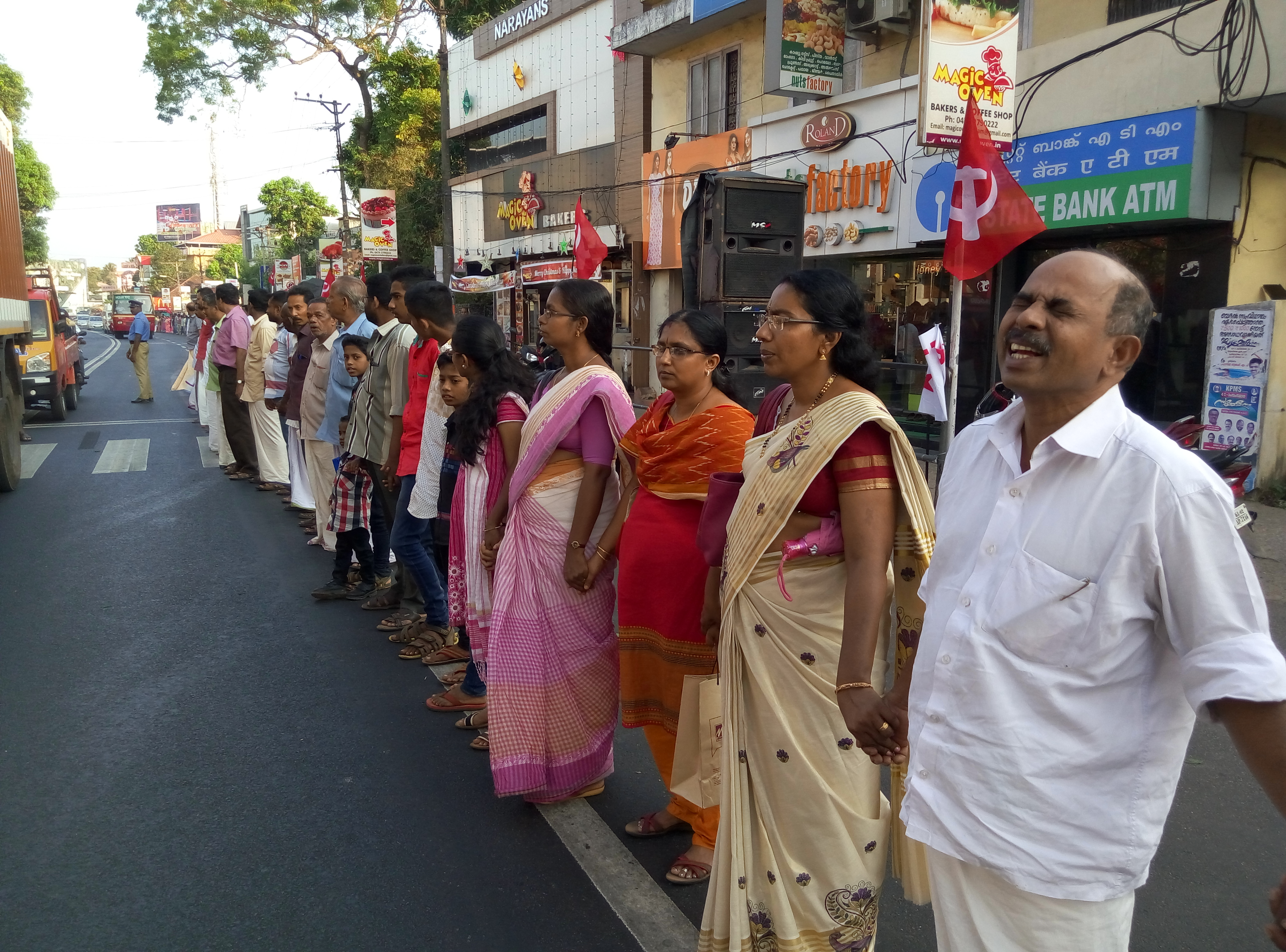 People holding hands in a human chain against Demonetisation 2: The Return of INR 1,000.