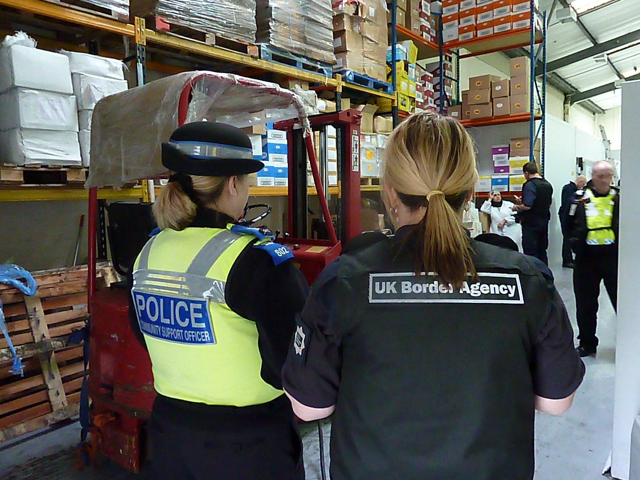 UK Border Agency and police conducting a raid