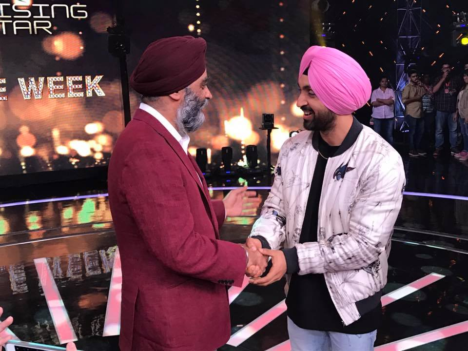 Diljit Dosanjh (left) with Harjit Sajjan