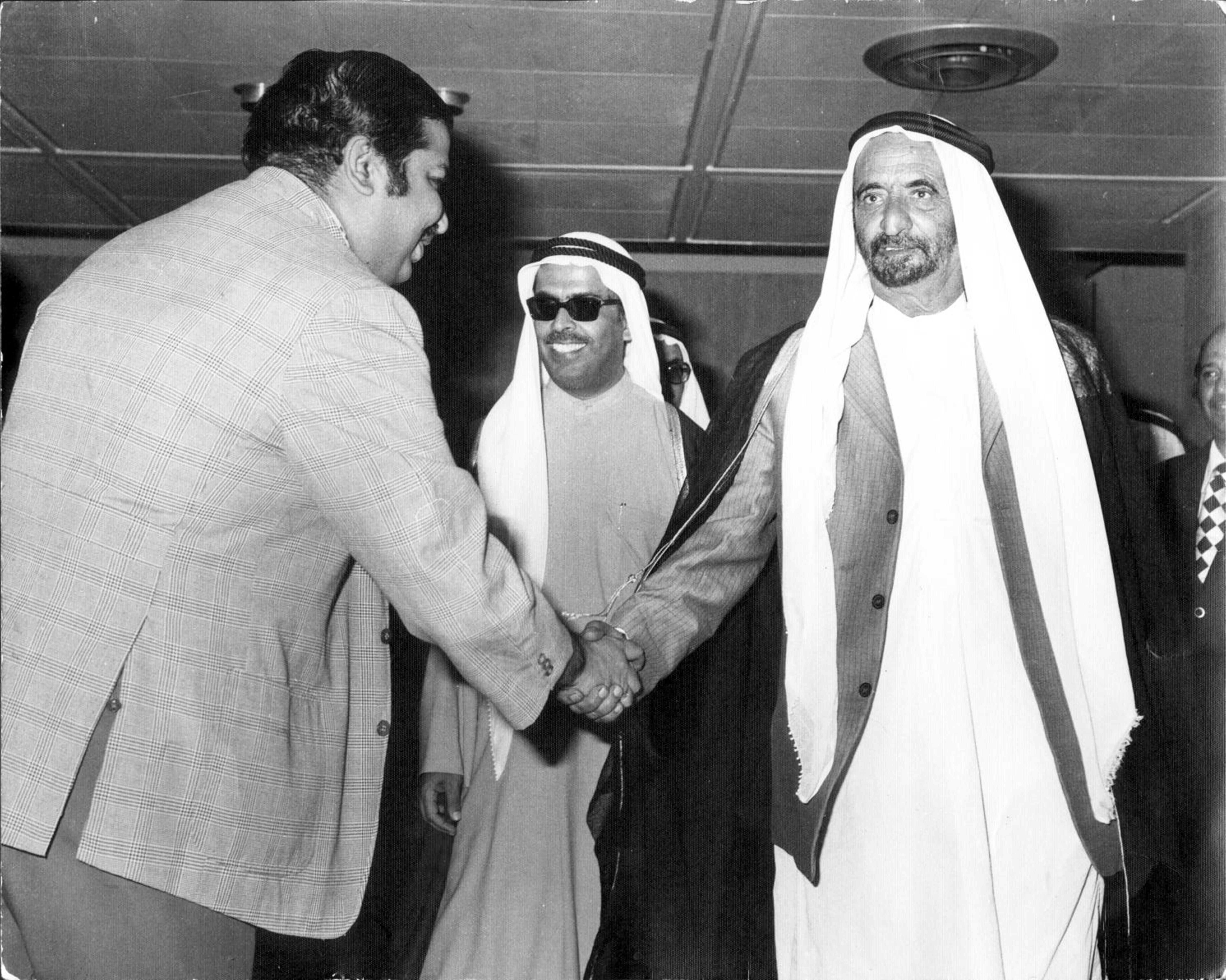 Meeting the late HH Sheikh Rashid bin Saeed Al Maktoum, then Ruler of Dubai, at a trade fair organized by Dubai Chamber of Commerce and Industry in the late 1960s. Saif Al Ghurair, the then President of the Chamber is in the centre. Photo courtesy: ITL Cosmos Group