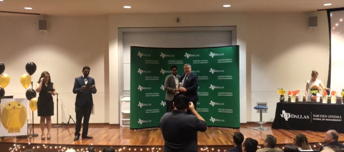 Abinav Varma receiving the award from Dean of Business School at the awards ceremony.