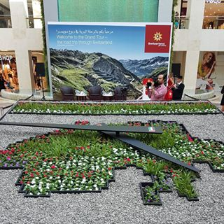 This 'flower clock' has been made of thousands of natural flowers.