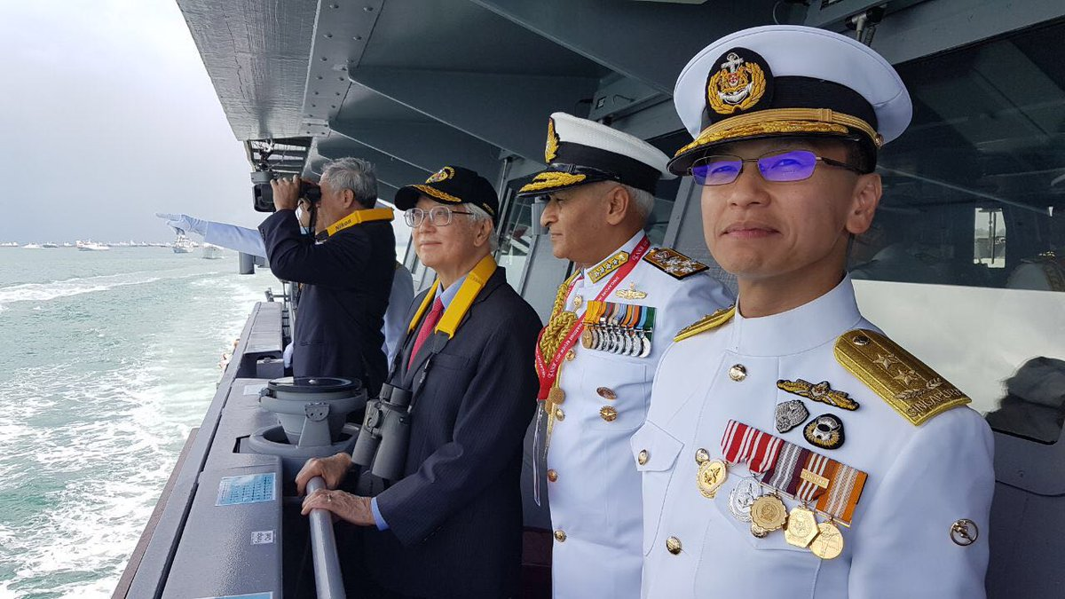 Indian navy chief Admiral Sunil Lanba with Singapore President Tony Tan Keng Yam and Singapore navy chief Rear Admiral Lai Chung Han on board RSS Independence during International Maritime Review