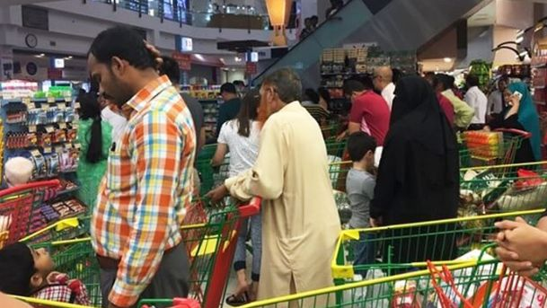 People flocking to supermarkets in Doha to purchase essential commodities.