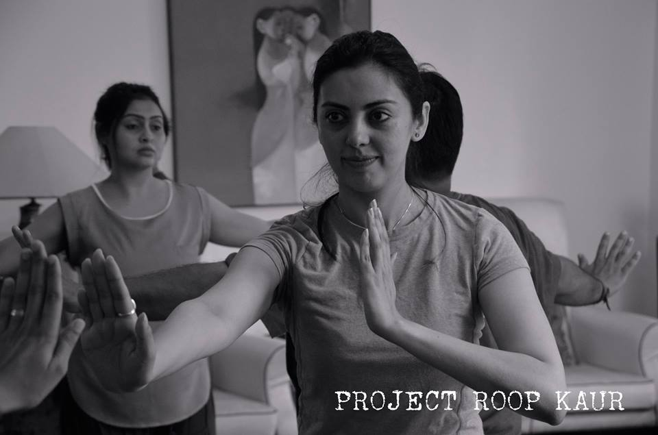 Ambreen Hamza concentrating on doing some of the mirror exercises that the Director, Edmund Chow, has instructed.
