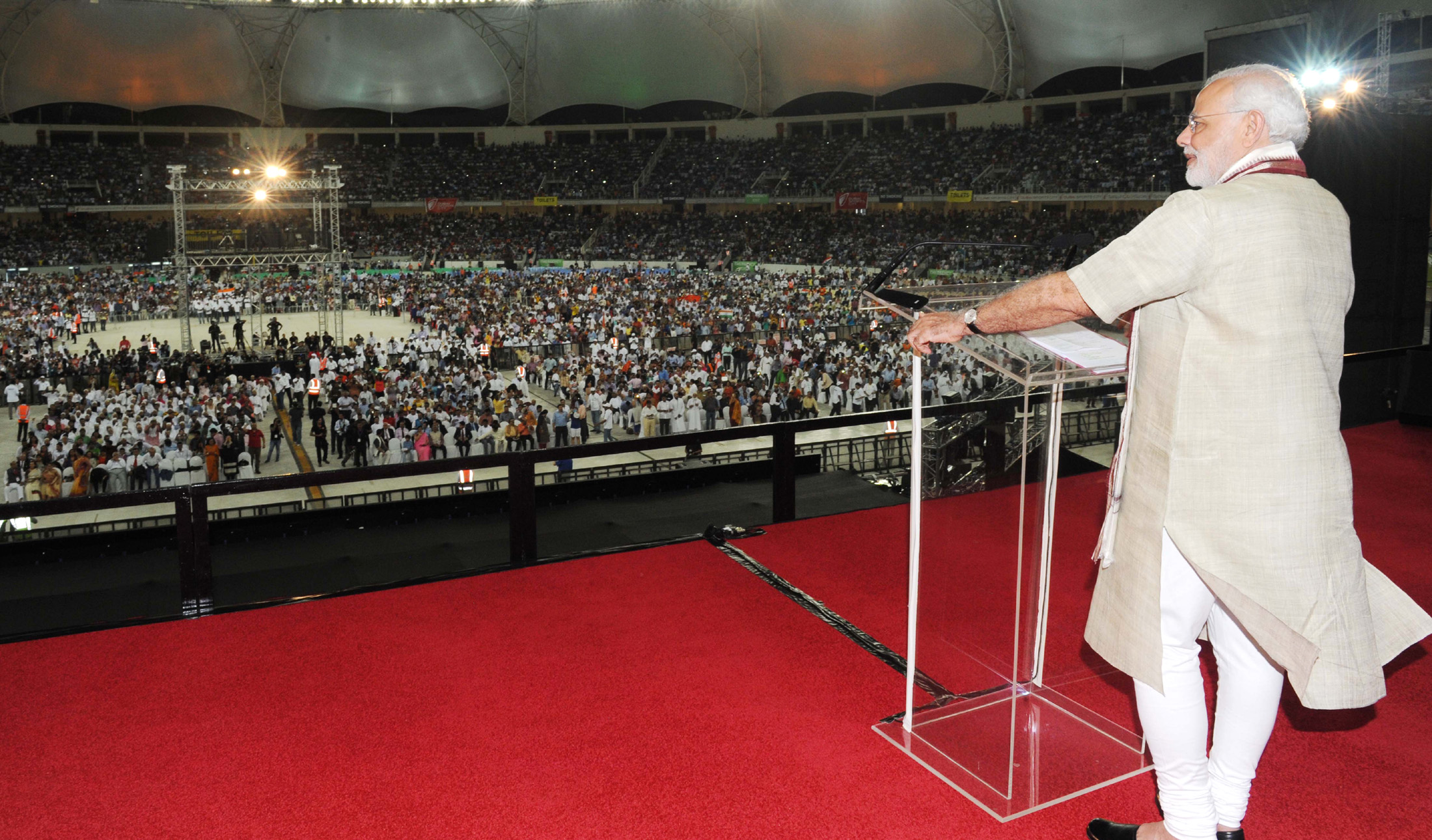 Indian Prime Minister Narendra Modi announced Indian Community Welfare Fund for those is distress while addressing the Indian Community Reception in Dubai Cricket Stadium, UAE. Photo Courtesy: PIB