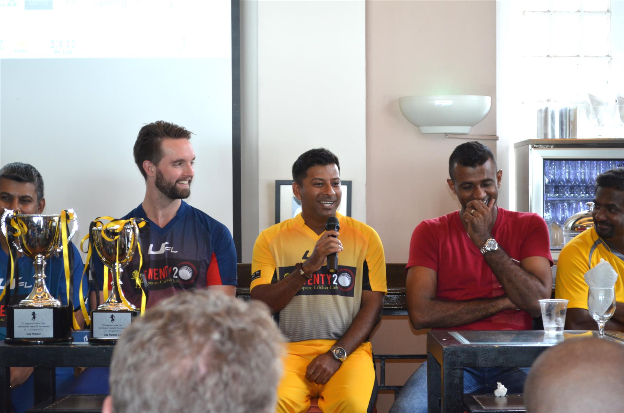 Muttiah Muralitharan (right) and Ferveez Maharoof (2nd right) laugh as SCC captain Riaz Hussein makes a joke about forgetting his well prepared game plan as soon as he met the two aces. Melbourne captain Matthew Brown (left) is also seen.