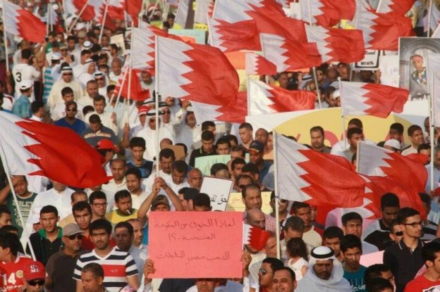 People holding flags during Bahrain Justice and Development Movement