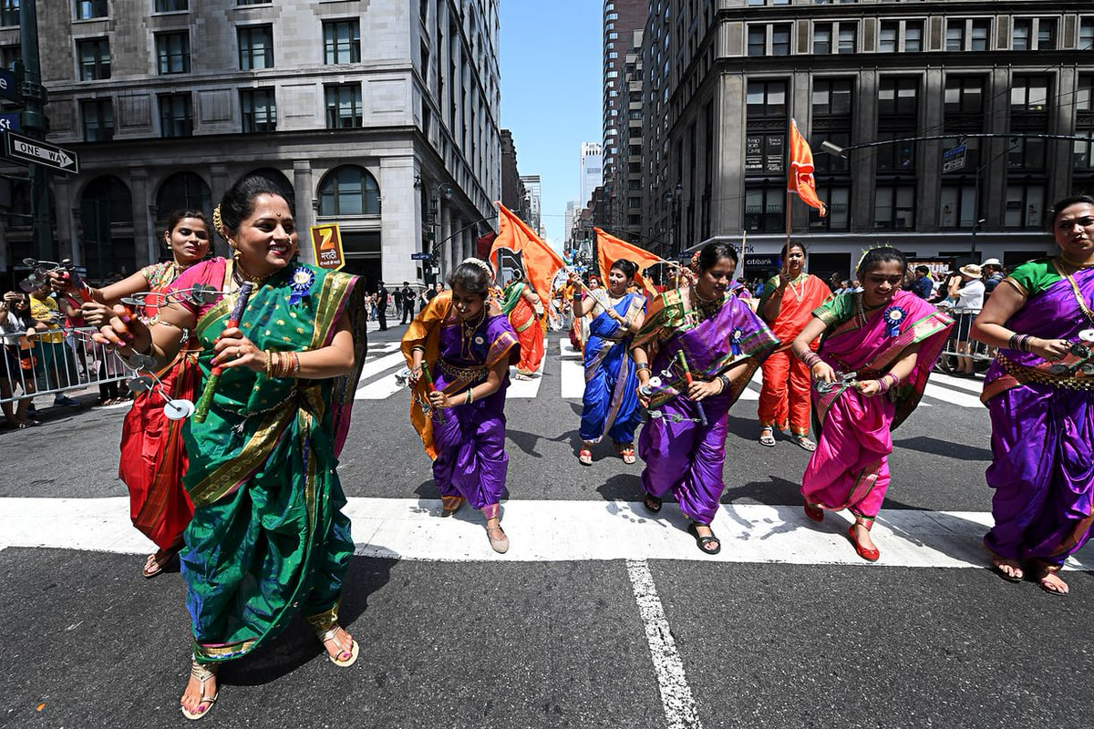 Women are seen walking at the India Day Parade in Nwe York.