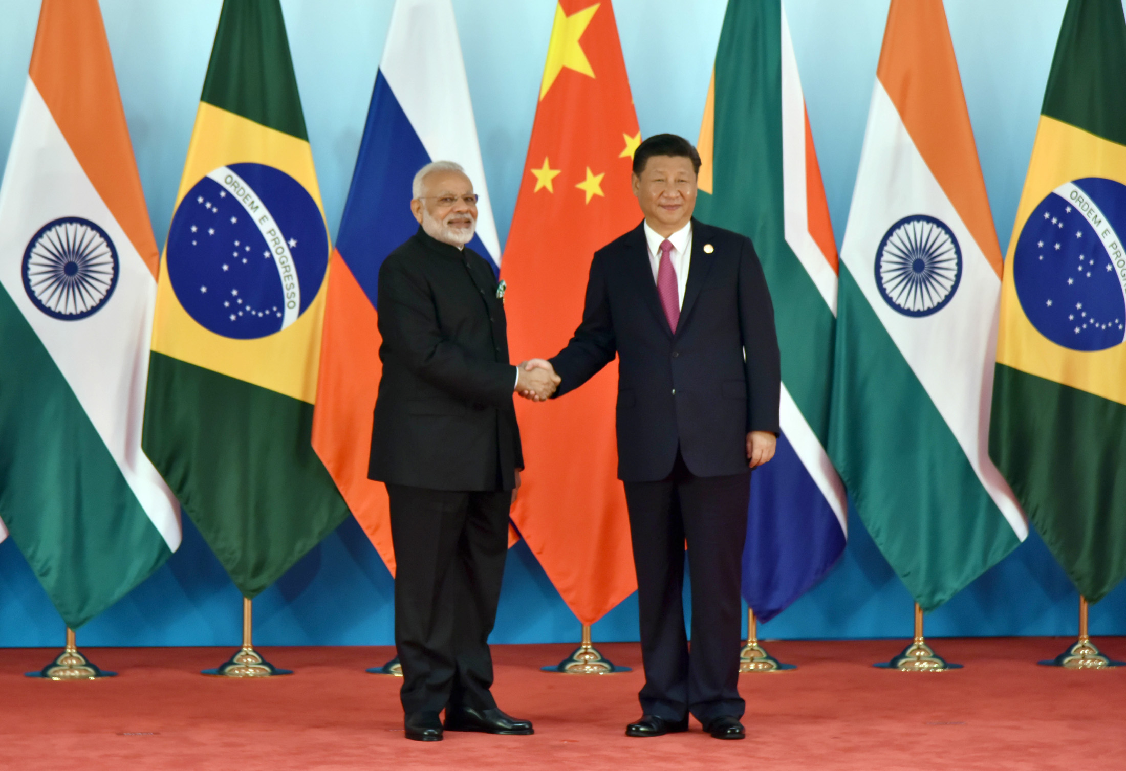 Prime Minister Narendra Modi being welcomed by the President of the People's Republic of China Xi Jinping, at the 9th BRICS Summit, in Xiamen