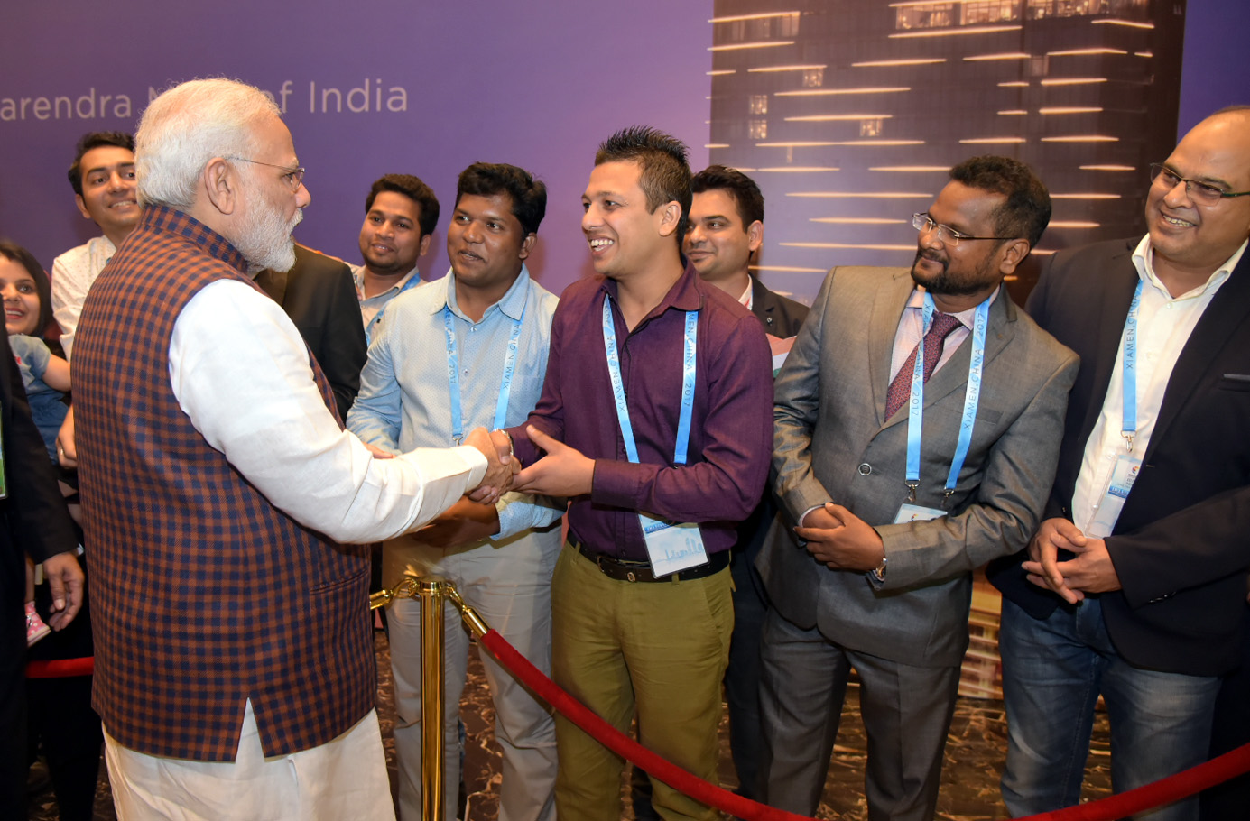 PM Modi greeting Indians who came to meet him in XIamen.