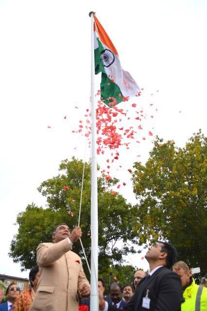 INdian High Commissioner to the UK YK SInha unfurling the national flag at the Indian Gymkhana in London. Photo courtesy: Twitter/@HCI_London