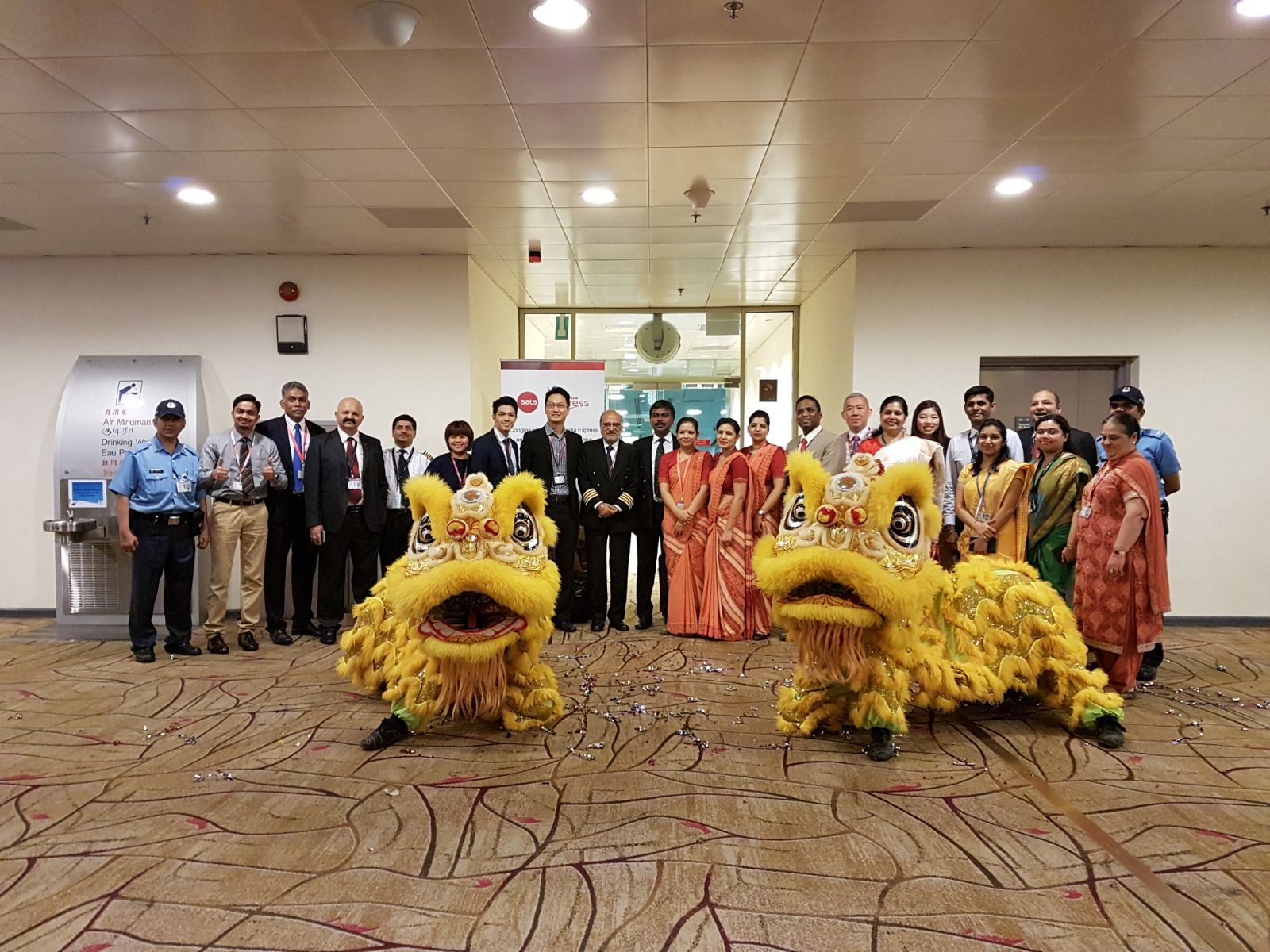 Beaming members of the Air India and Changi Airport Group (CAG) teams pose with the lions considered auspicious at business opening events in the Singapore Chinese culture.