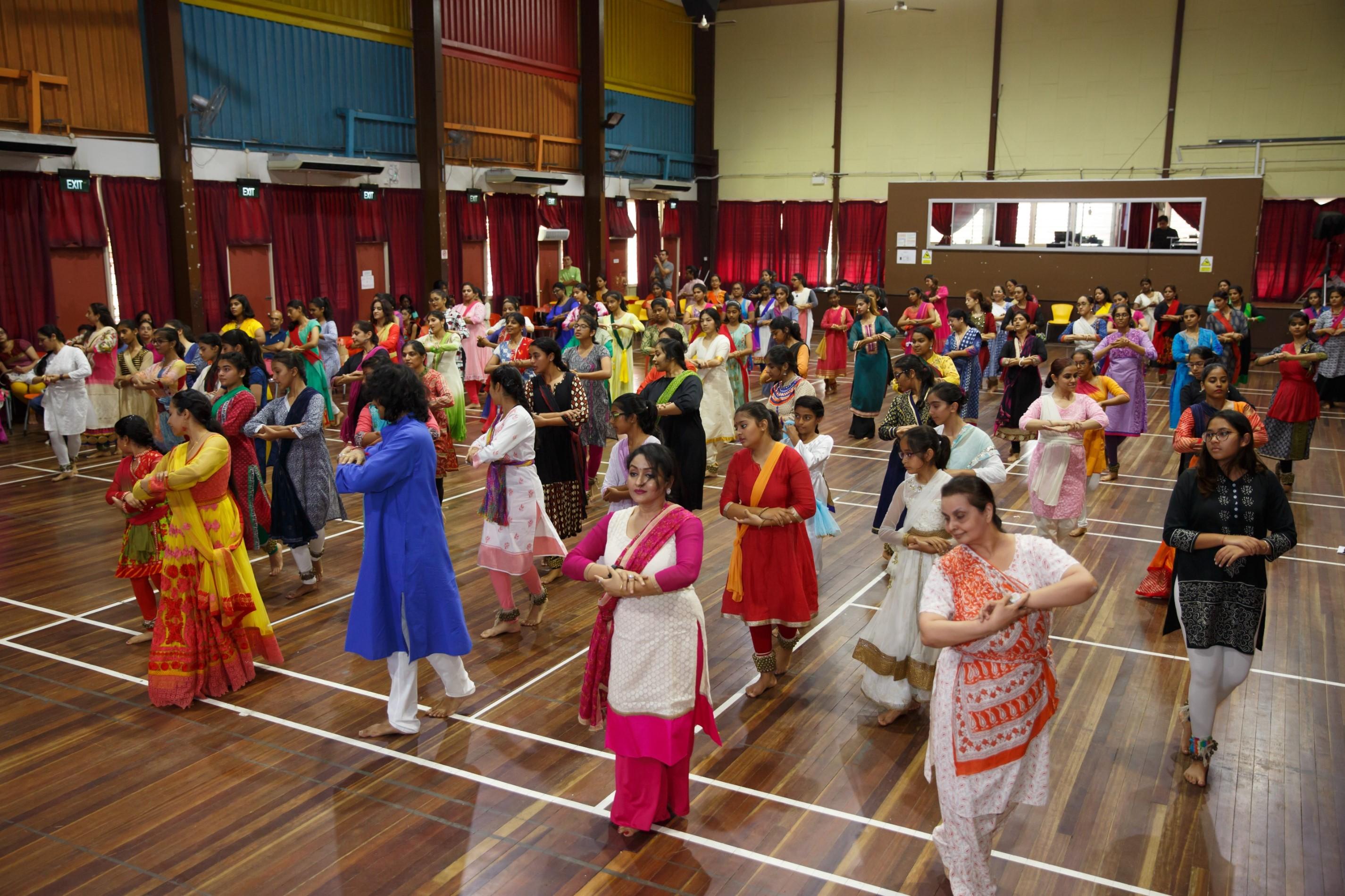 Workshop particpants practicing Kathak movements under Pandit Birju's tutelage.