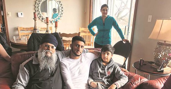 Sunny Dhalliwal (centre) with his family.