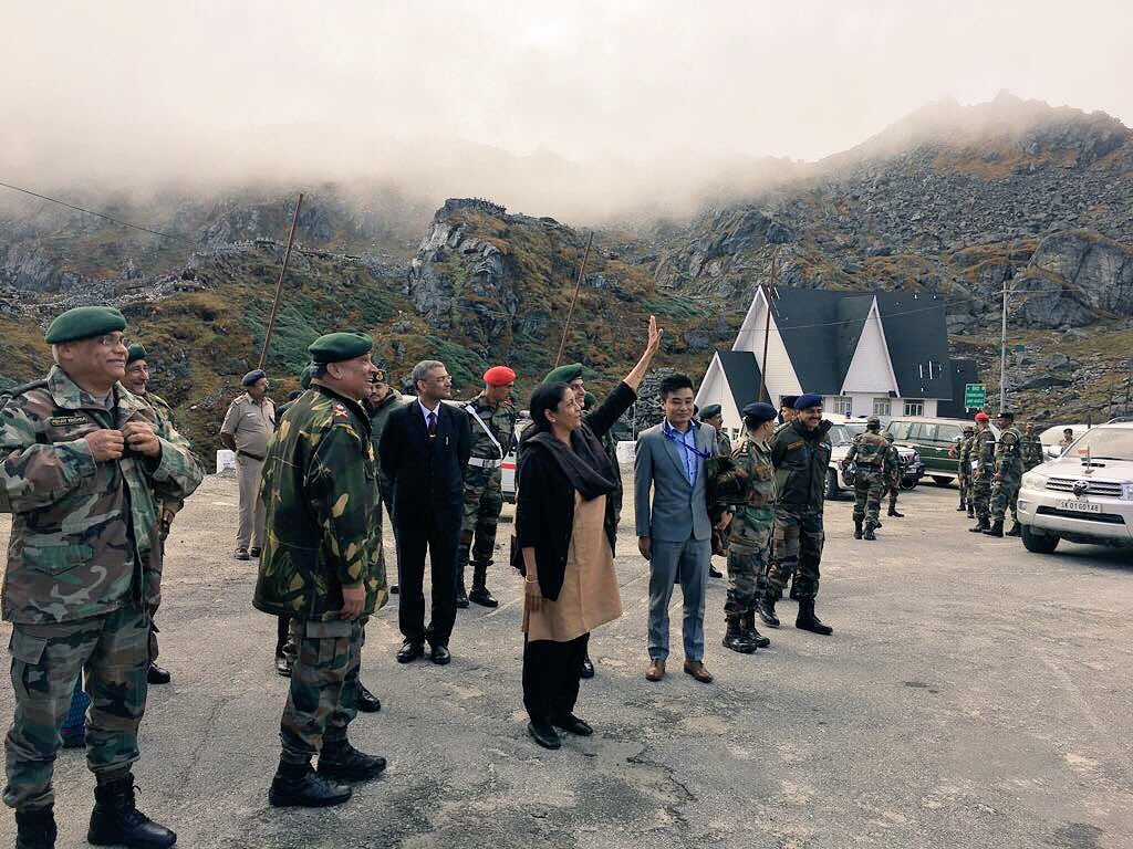 Indian Defence Minister Nirmala Sitharaman waves to Chinese citizens and troops (unseen) across the border at the Nathhu La outpost.