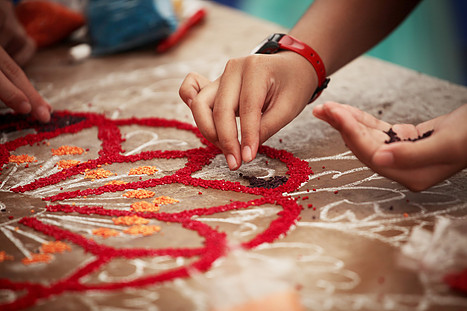 People decorate their gateways with beautiful rangolis.