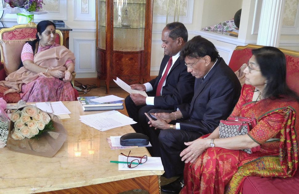 India's External Affairs Minister Sushma Swaraj (left) with delegates discussing Indian-American issues