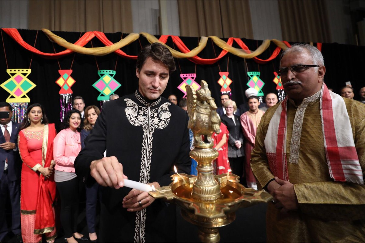 Canada PM Justin Trudeau lighting the lamp for Diwali.