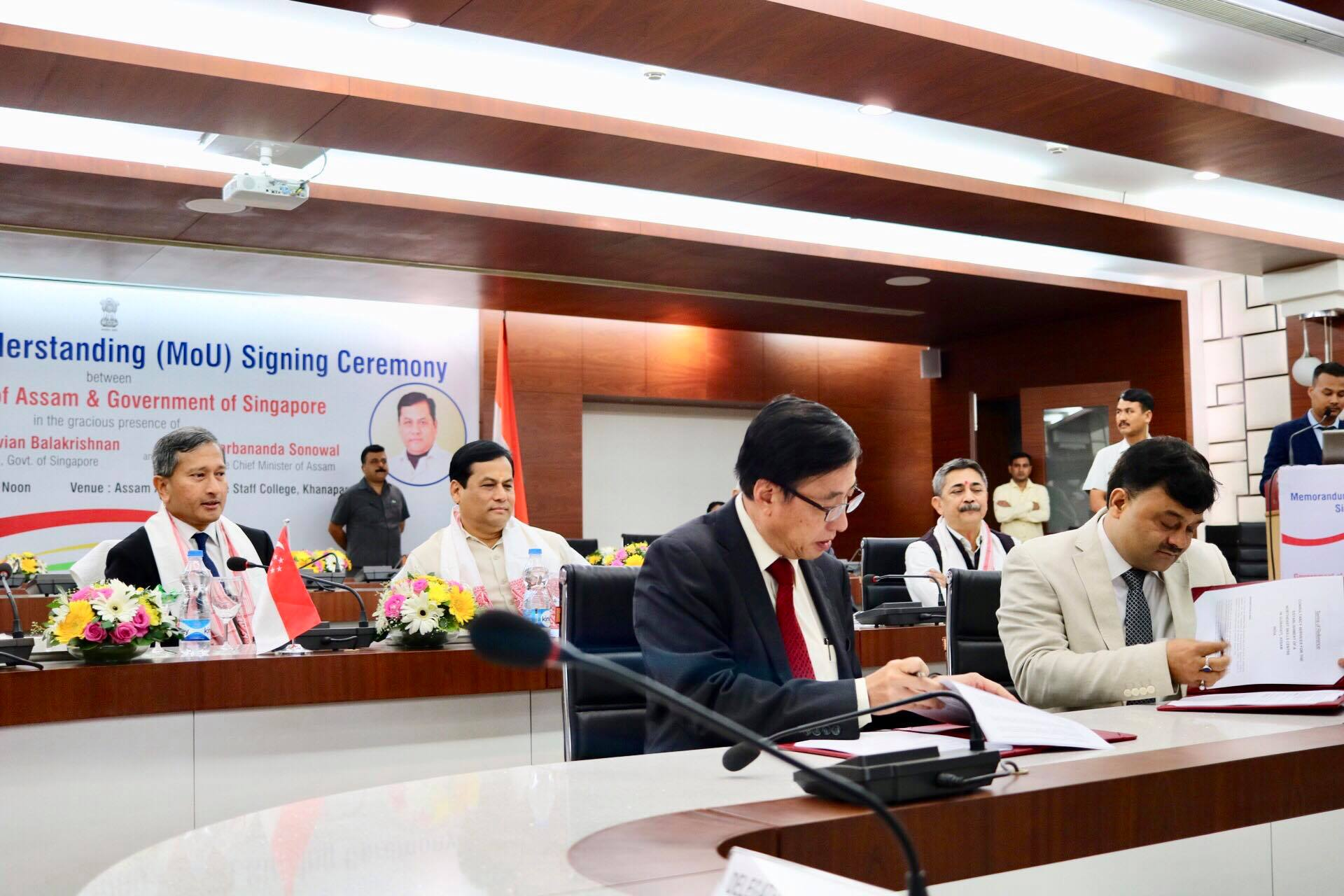 Singapore Minister for Foreign Affairs Dr Vivian Balakrishnan looks on the signing of Terms of Reference on the North East Skills Centre by ITE Education Services CEO Bruce Poh and Assam Skills Development Mission Director Anand Prakash Tiwari.