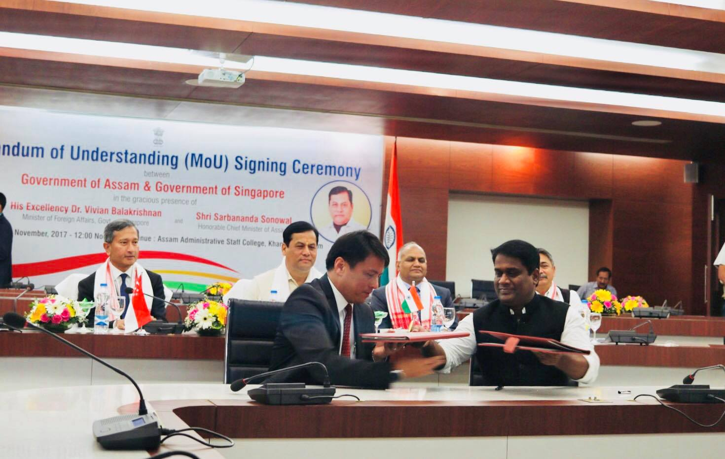 Singapore Minister for Foreign Affairs Dr Vivian Balakrishnan looks on the signing of MoU on City Greening by Singapore Cooperation Enterprise CEO Kong Wy Mun and Guwahati Metropolitan Development Authority Madhaiyaan Angamuthu.