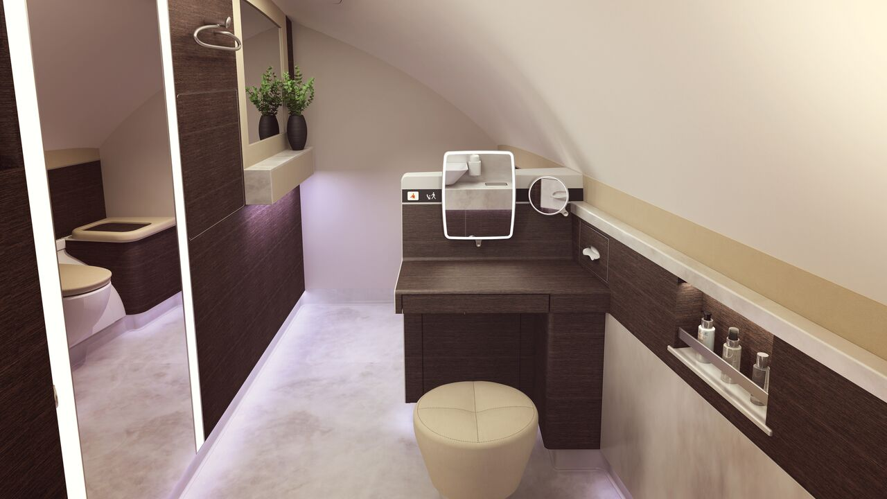 There is also a sit-down vanity counter in the stylishly furnished lavatory.