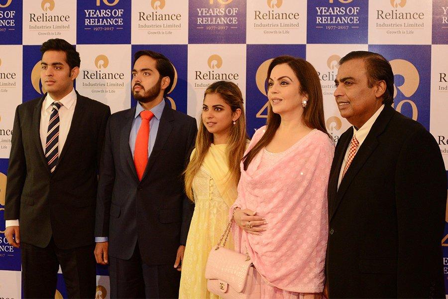 Mukesh Ambani (right) with his family.