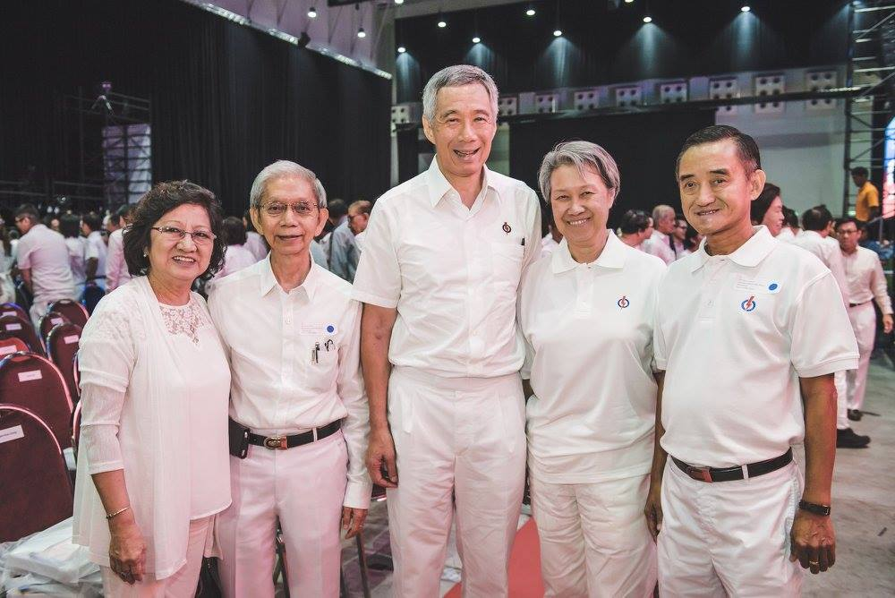 PM Lee Hsien Loong along with comrades Tan Seng Peng (second from left) and Goh Khon Chong (extreme right). Both comrades have served the PAP for 50 years.