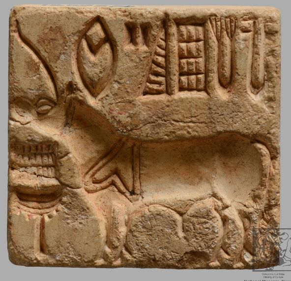 A square seal depicting an engraved unicorn with incense burner and an inscription with 5 pictograms