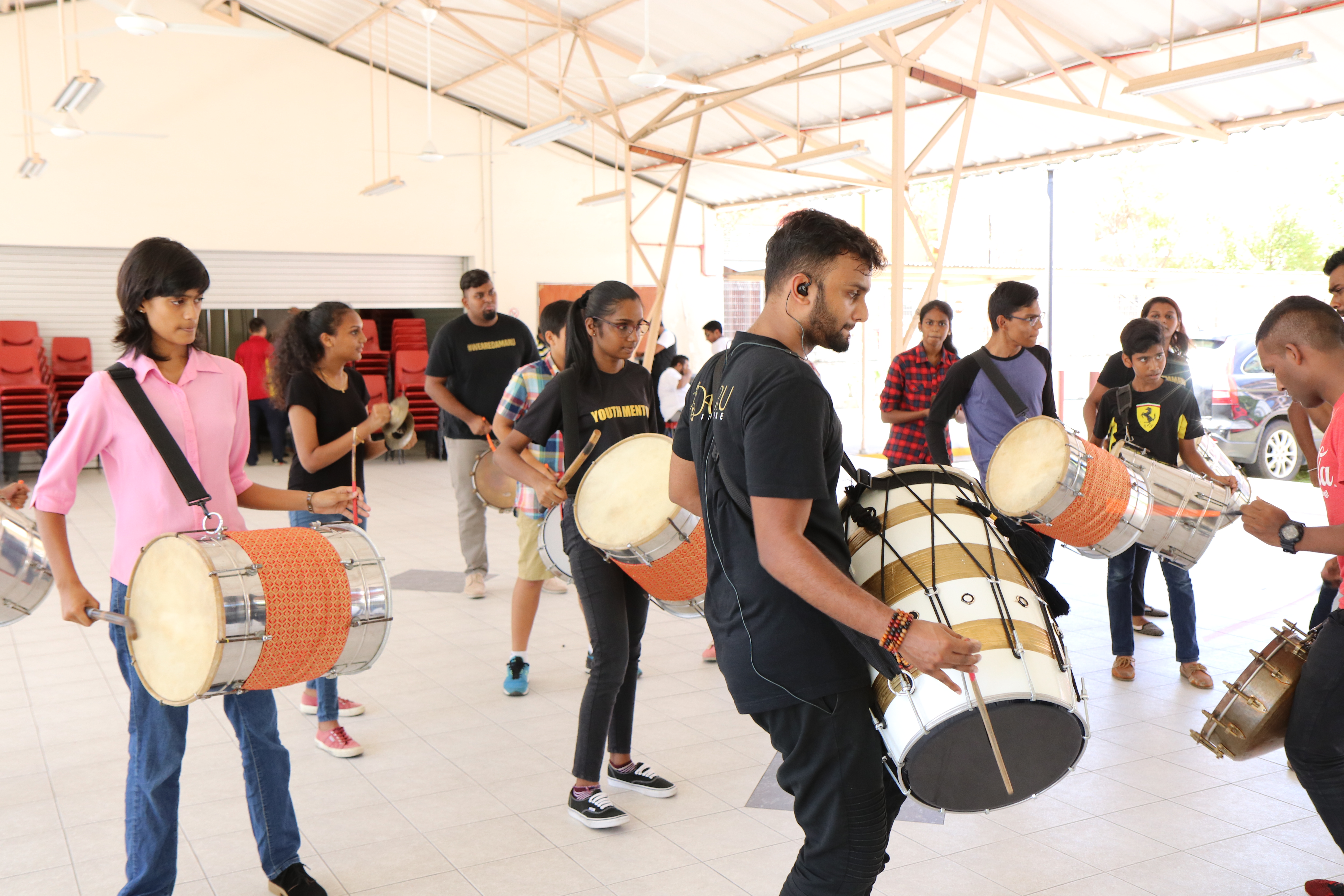 SINDA trains youth in playing various musical instruments.