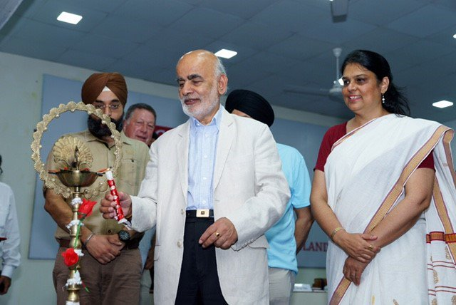 Lord Diljit Rana lighting the lamp to commemorate the opening of the football academy.