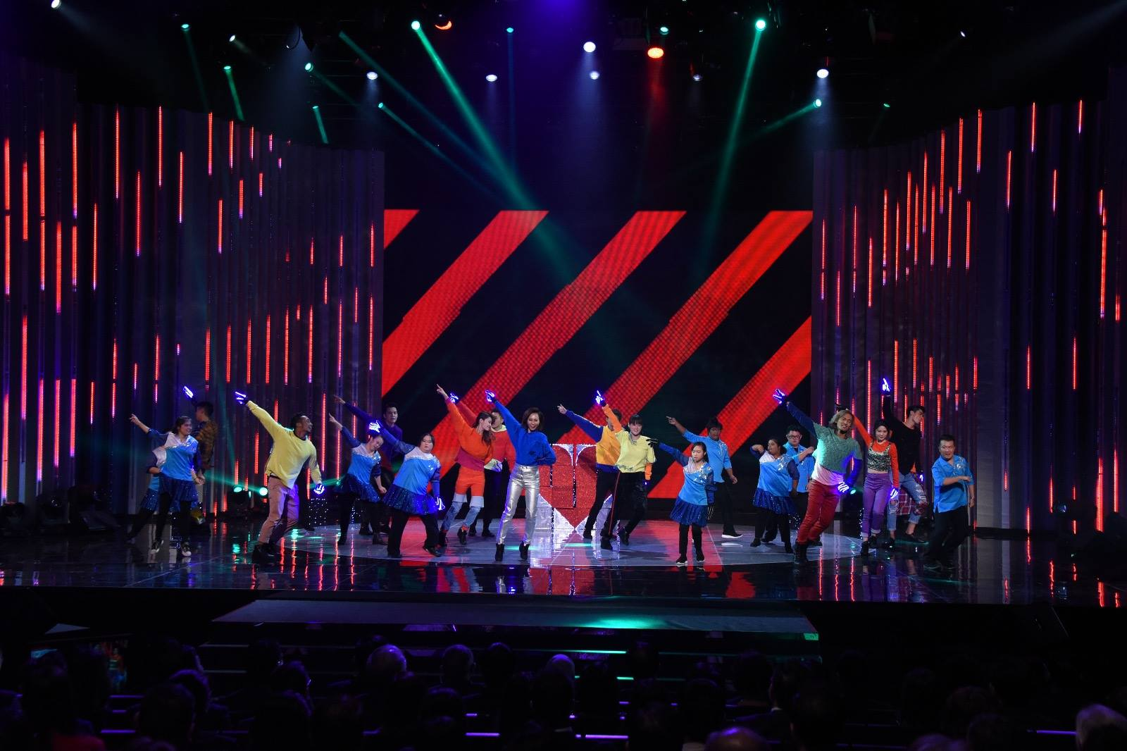 Artistes with members of the Down Syndrome Association putting up a dazzling dance performance at the President's Star Charity programme in Singapore.