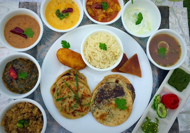 Aaloo Daal Pakora, til ki chutney (made with coriander & sesame seeds), gahat ka shorba, kappa, phanu, jholi (curd & chick pea flour curry), meetha bhaat, chol roti, lesu and the dessert, roat make a delicious thali