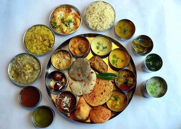 The elaborate thali comprises of dal baati churma, missi roti, gatte ki sabji, panchmela dal, laal maas, bajra roti, buttermilk and desserts like malpuas and halwa