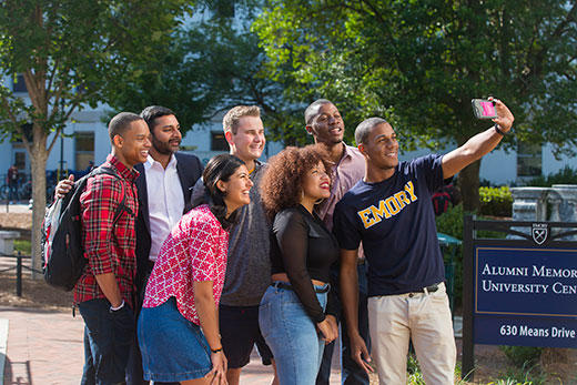 Ajay Nair (second from left), Emory's senior vice president and dean of Campus Life, poses with students. Nair will leave Emory after March 31 to become the next president of Arcadia University.