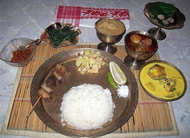 The delicious thali has meat dish, fish, fresh vegetables, aloo pitika, dal and saag