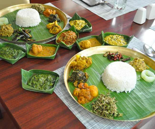 Seasoned with the spicy chili pepper, Manipuri thali consists of rice, fish, leafy vegetables, Tan Ngang (bread) and the irresistible dessert Chahao Kheer, which is made with black rice