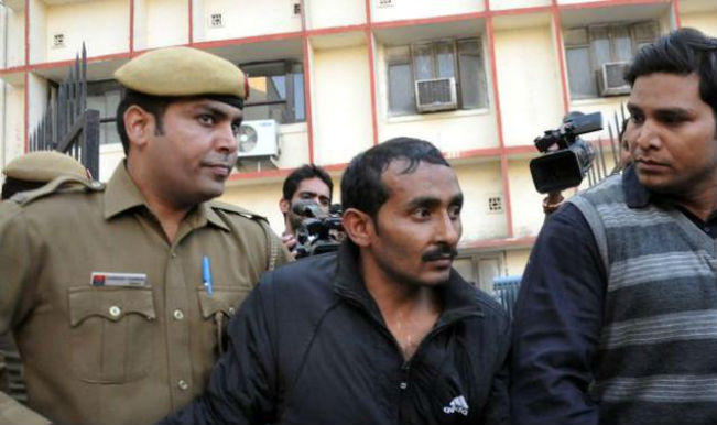 Indian police are shown escorting former Uber taxi driver and rapist Shiv Kumar Yadav (center) following his court appearance in New Delhi on Dec. 8, 2014.