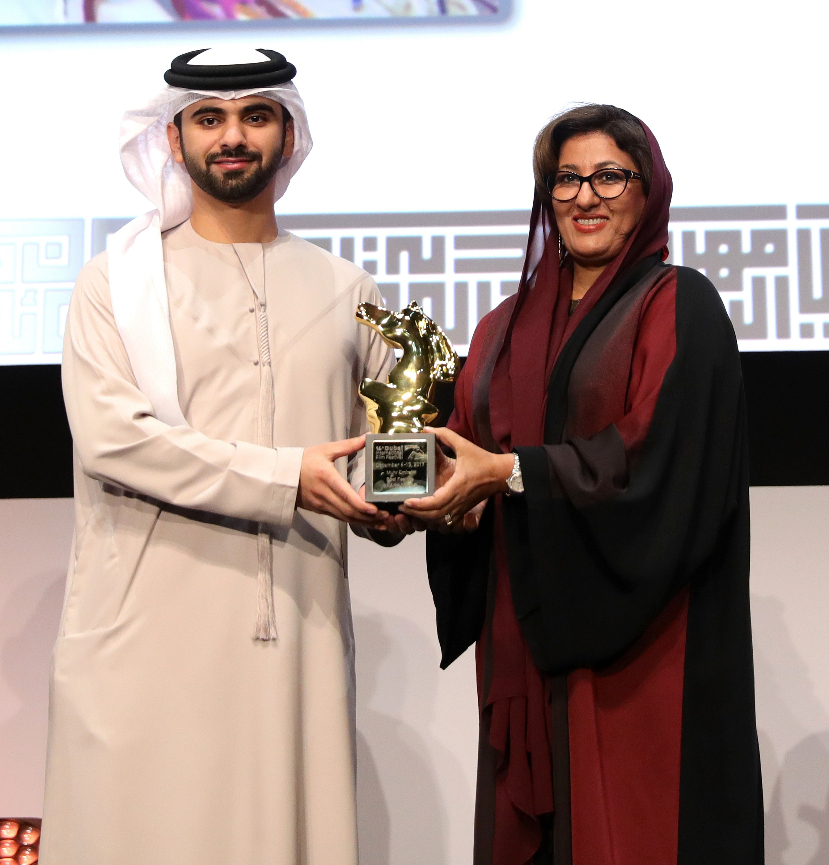 His Highness Sheikh Mansoor bin Mohammed bin Rashid Al Maktoum presenting the award of the Best Emirati Feature Film to director Nujoom Alghanem for her film 'Sharp Tools'.