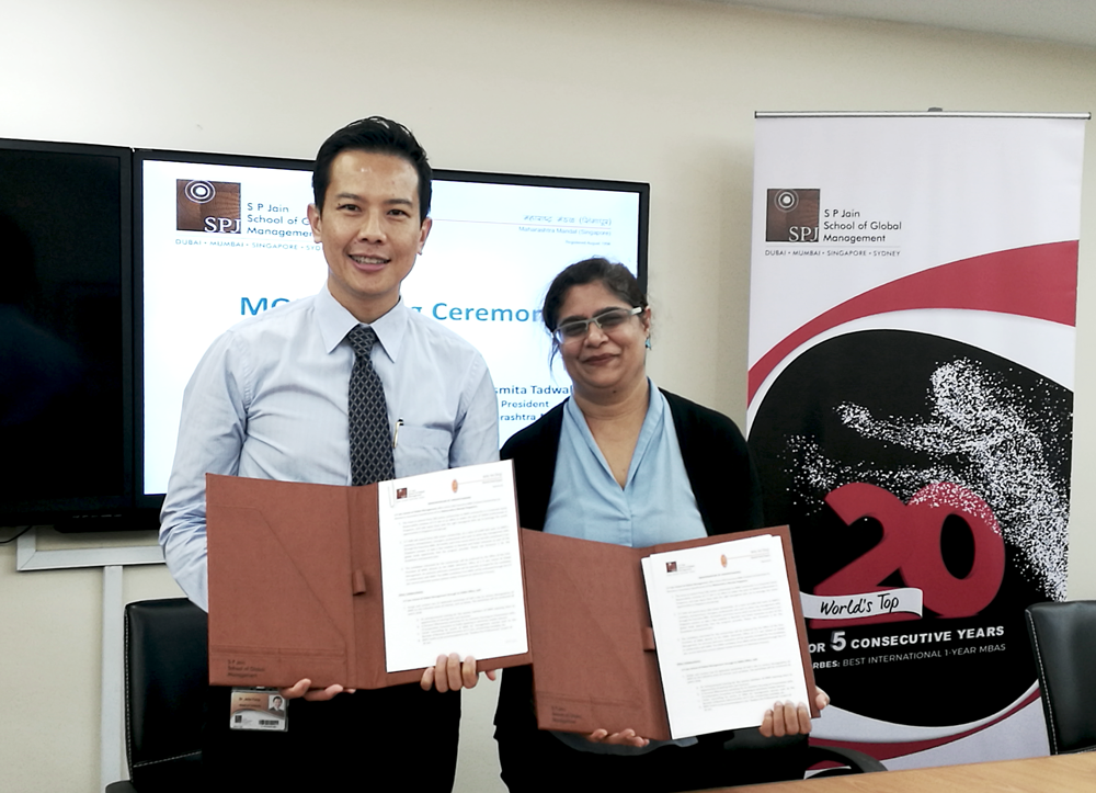 Dr John Fong (left), CEO and Head of Singapore Campus at SP Jain School of Global Management and Asmita Tadwalkar, President of Maharashtra Mandal Singapore showing the signed MOU.