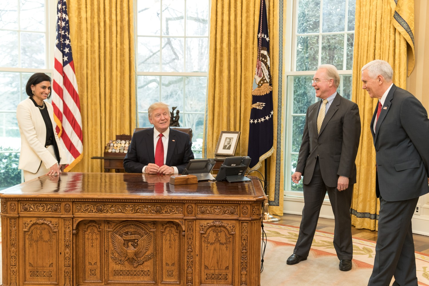 US President Donald Trump shares a laugh with (clockwise from left) Seema Verma, Administrator of the Centers for Medicare and Medicaid Services, Secretary Tom Price, U.S. Secretary of Health and Human Services, and Vice President Mike Pence in the Oval Office of the White House.