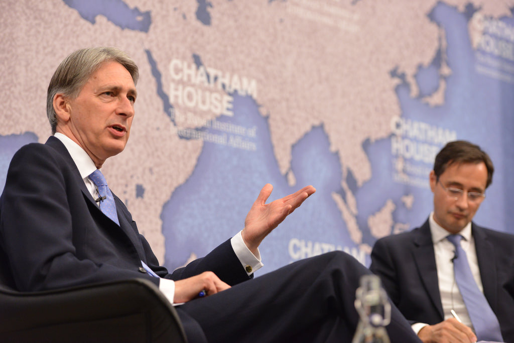 UK Chancellor of the Exchequer Phillip Hammond (L).