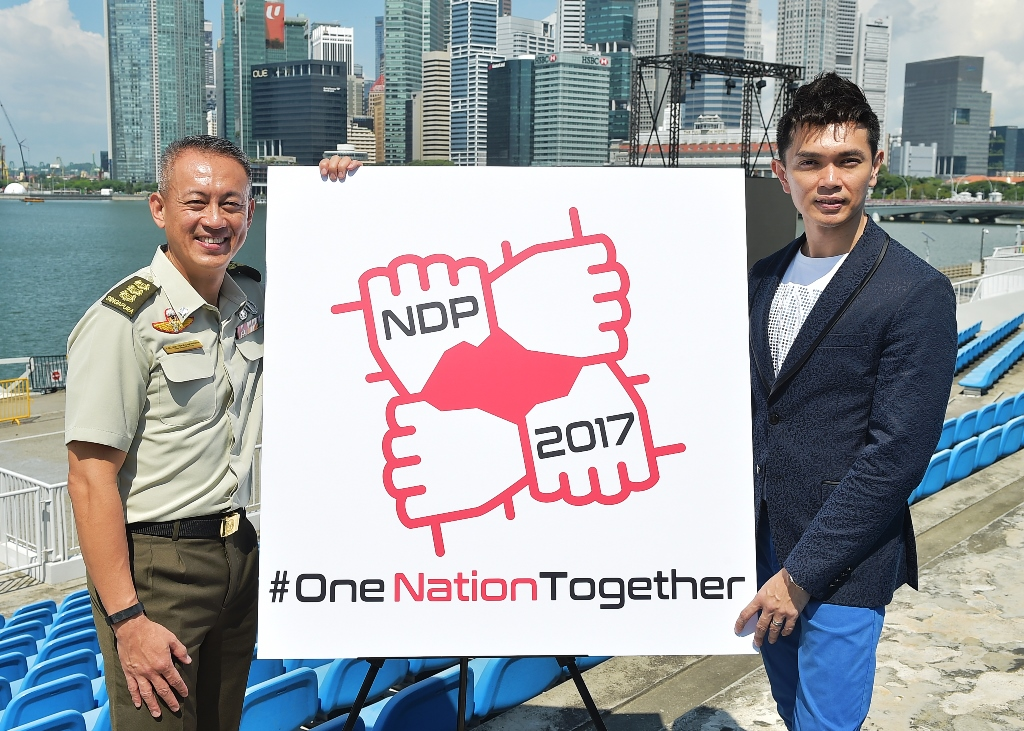 Colonel Melvin Ong (left), Chairman of the National Day Parade (NDP) 2017 Executive Committee  together with Jay Lim, lyricist and singer of the NDP 2017 theme song  at The Float @ Marina Bay.