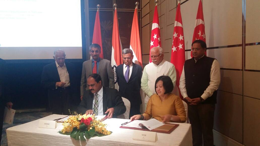 Margaret Toh, Executive Director, YCH Group signing the MOU with the Haryana State Industrial and Infrastructure  Development Corporation (HSIIDC) representative Photo: IE Singapore