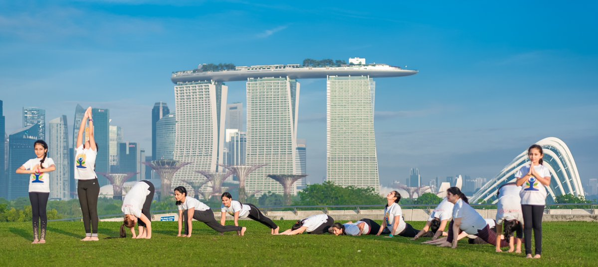 People practicing yoga in Singapore.