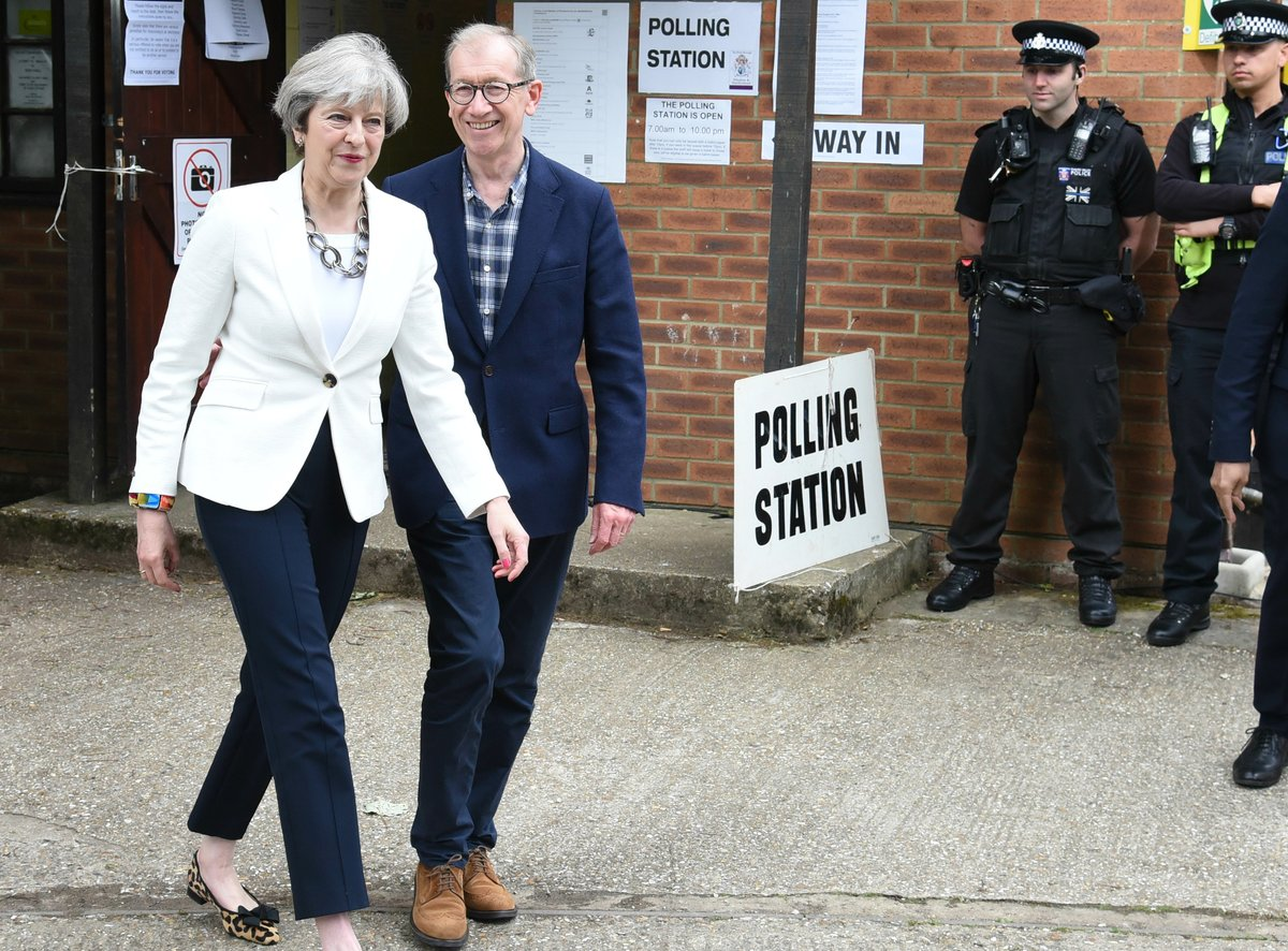 Theresa May and her husband Philip vote at their local polling station in Sonning, Berkshire.