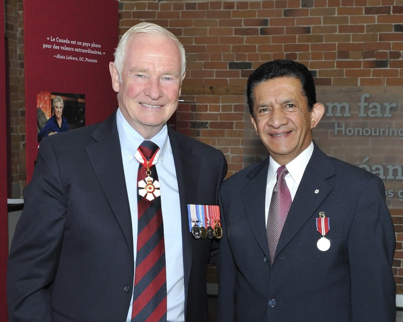 Sultan Jessa (right) after being awarded teh Queen's Commonwealth Medal.