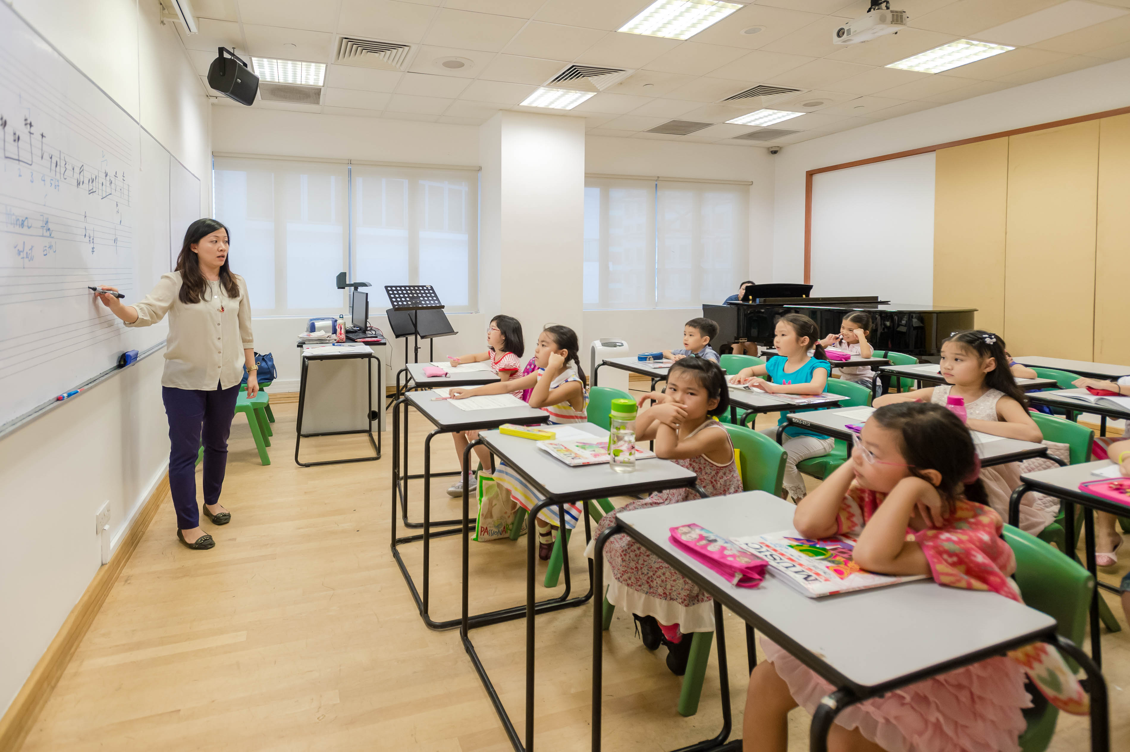 Children attending a class room in Singapore.