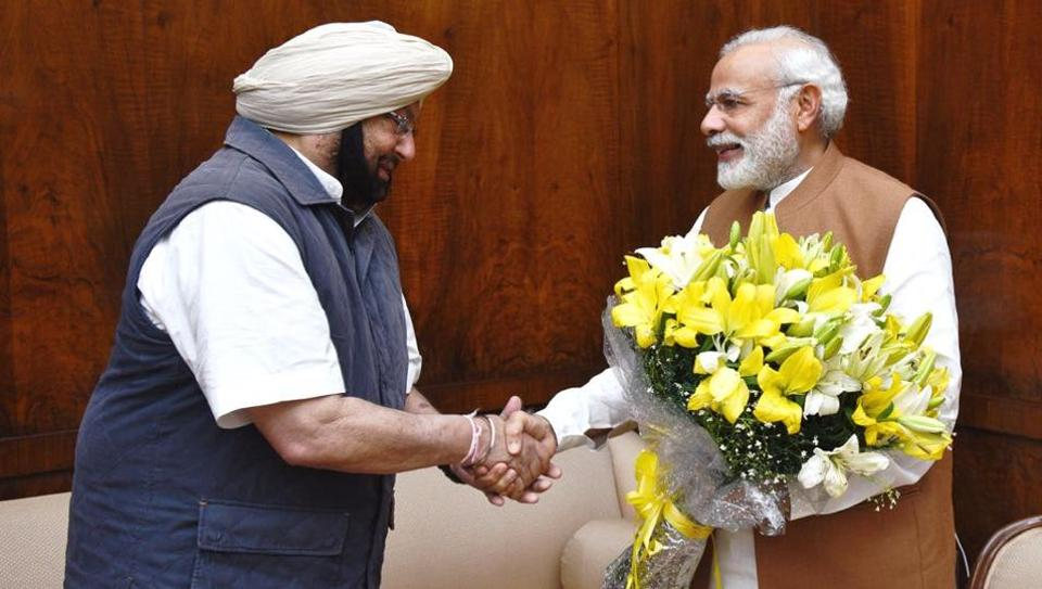 Punjab CM Capt Amarinder Singh (left) with Indian PM Narendra Modi.